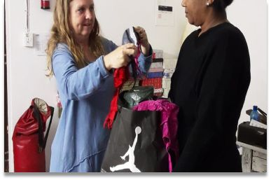 Person handing over packet for bring a bra campaign